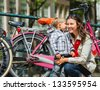 Tourists in Amsterdam. Mother and son walking in the streets of Amsterdam. The Netherlands - stock photo