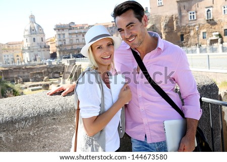 Tourists in Rome standing in front of Foro traiano