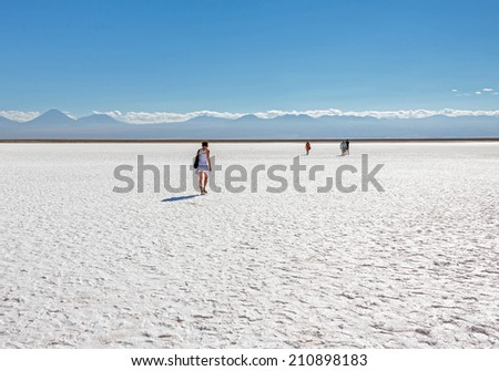 Tourists in saline lagoon near San Pedro de Atacama - Chile