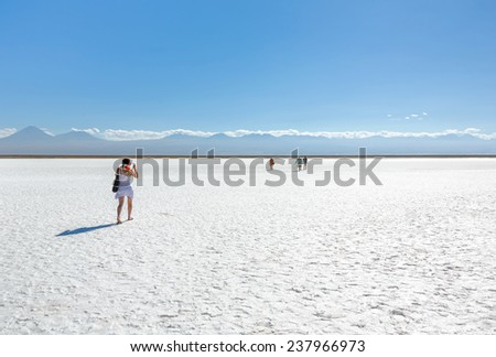 Tourists in saline lagoon near San Pedro de Atacama - Chile, Latin America