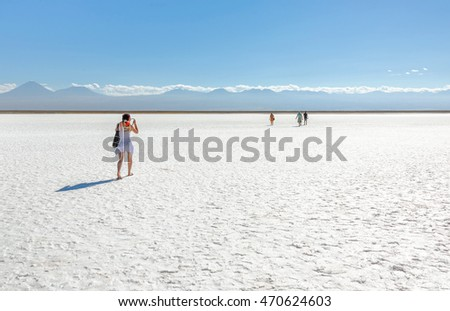 Tourists in saline lagoon near San Pedro de Atacama - Chile, South America.