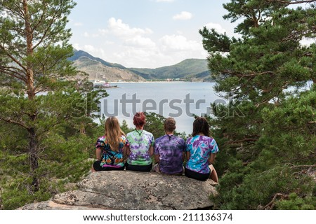 Tourists in the camp at rest, enjoy nature and food - stock photo