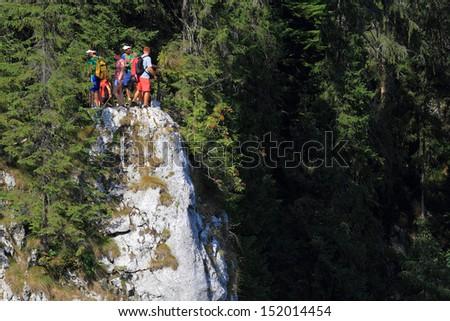 Tourists in the Occidental Carpathians, Romania, Europe - stock photo