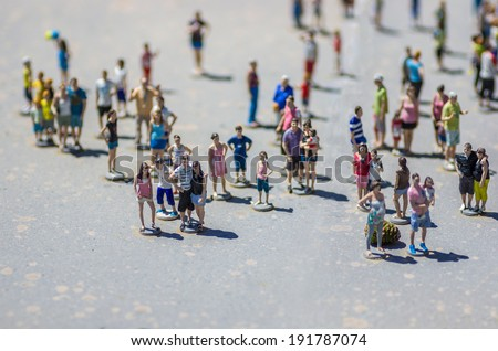Tourists miniature people - stock photo