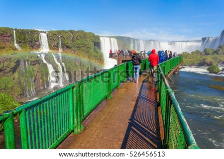 Tourists near the Iguazu Falls, waterfalls of the Iguazu River on the border of the Argentina and the Brazil. It's one of the New 7 Wonders of Nature.