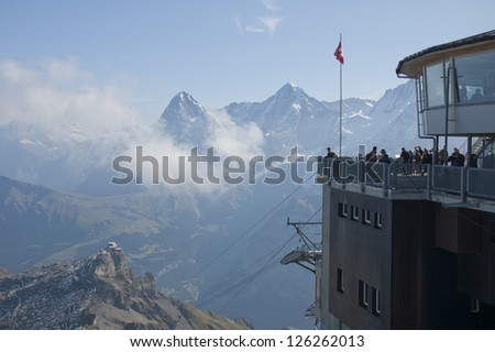 Tourists observe the Swiss Alps from Schilthorn, Switzerland