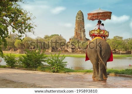 Tourists on an elephant ride tour of the ancient city Ayutaya ,thailand - stock photo