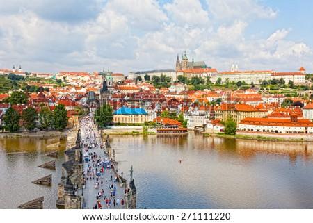 Tourists on Charles Bridge, Prague,Czech Republic - stock photo