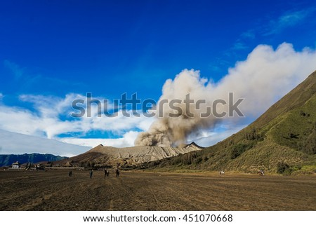 Tourists on horses riding to Bromo volcano, Java, Indonesia - stock photo