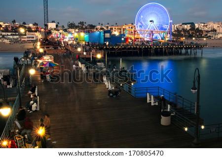 Tourists on Santa Monica Pier, Santa Monica, Los Angeles County, California, USA - stock photo