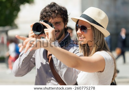 Tourists photographing and having fun in a city