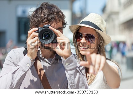 Tourists photographing and having fun in a city - stock photo