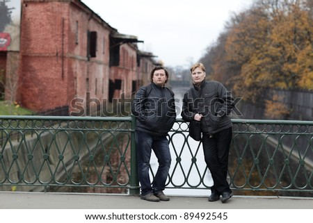 Tourists posing on the fortification background in kronstadt, Russia - stock photo