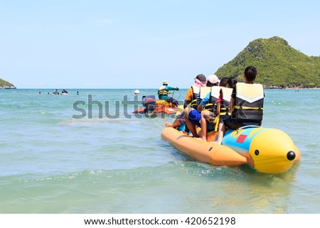Tourists riding the rubber boat in ocean