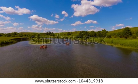 tourists row on rafts, catamarans. rafting on the river. aerial photography