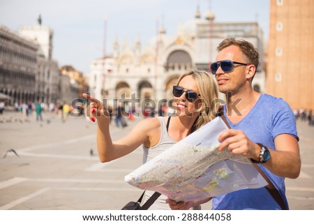 Tourists sightseeing in Venice - stock photo