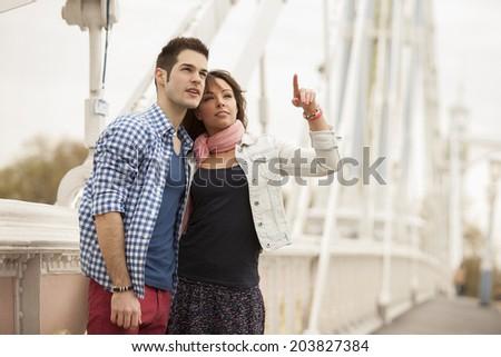 tourists standing on Albert bridge - stock photo