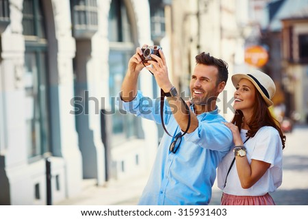 Tourists taking photo in the city