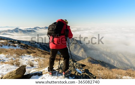 Tourists taking photos of the fog on Deogyusan mountains,South Korea
