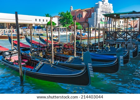 Tourists travel on gondolas at canal Venice, Italy . Gondola trip is the most popular touristic activity in Venice.
