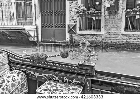 Tourists travel on gondolas at canal Venice, Italy . Gondola trip is the most popular touristic activity in Venice. Old style, black - white photo.