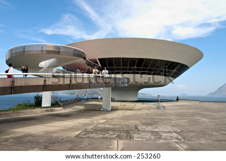Tourists visit the Museum of Contemporary Art, Niterói, designed by Oscar Niemeyer. The museum is located in Rio de Janeiro. - stock photo