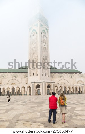 Tourists visiting Hassan II Mosque or Grande Mosquee Hassan II in Casablanca, Morocco, by misty morning