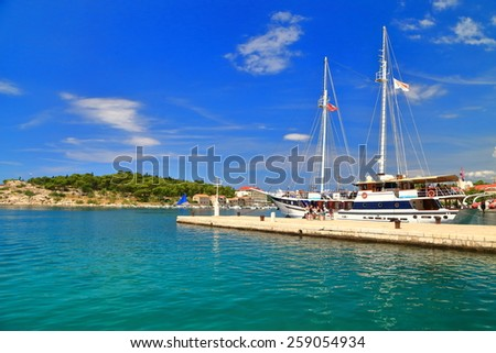 Tourists waiting near large sail boat anchored by the pier, Makarska,Croatia - stock photo