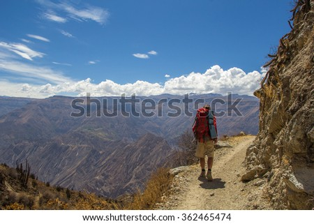 Tourists walking along the trail in the Canyon Cotahuasi,  province of Arequipa, Peru. - stock photo