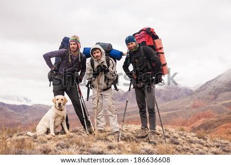 tourists who walk through the mountains on vacation - stock photo
