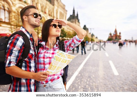 Tourists with map on street in city - stock photo