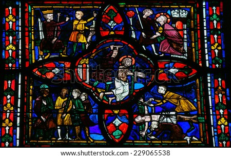 TOURS, FRANCE - AUGUST 14, 2014: Stained glass window dating from the 13th Century in the Cathedral of Tours, France. This window depicts the Torture of Jesus on Good Friday in the center. - stock photo