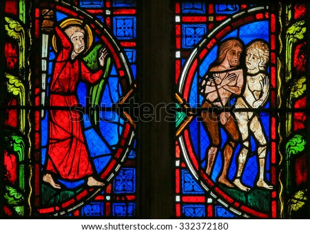 TOURS, FRANCE - AUGUST 14, 2014: Stained glass window depicting Adam and Eve expelled from Paradise in the Cathedral of Tours, France. - stock photo