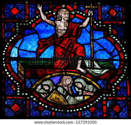 TOURS, FRANCE - AUGUST 8, 2014: Stained glass window depicting Jesus rising from his grave, in the Cathedral of Tours, France. - stock photo