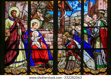 TOURS, FRANCE - AUGUST 14, 2014:  Stained glass window depicting the Epiphany, the Visit of the Three Kings in Bethlehem, in the Cathedral of Tours, France.
