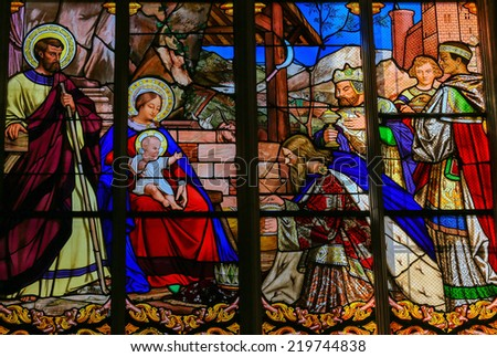TOURS, FRANCE - AUGUST 8, 2014: Stained glass window depicting the Epiphany, the Visit of the Three Kings in Bethlehem, in the Cathedral of Tours, France.