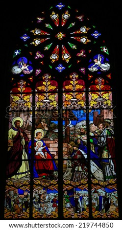 TOURS, FRANCE - AUGUST 8, 2014: Stained glass window depicting the Epiphany, the Visit of the Three Kings in Bethlehem, in the Cathedral of Tours, France. - stock photo
