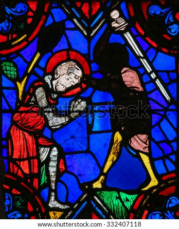 TOURS, FRANCE - AUGUST 14, 2014: Stained glass window depicting the execution of a martyr in the Saint Gatien Cathedral of Tours, France.