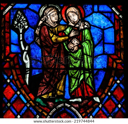 TOURS, FRANCE - AUGUST 8, 2014: Stained glass window depicting the Visitation, the visit of the Blessed Virgin Mary to her niece Elisabeth in the Cathedral of Tours, France. - stock photo