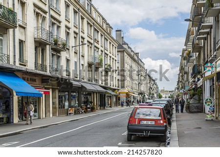 TOURS, FRANCE - JULY 20, 2012: View of street in medieval city of Tours. Tours - city in central France, capital of the Indre-et-Loire department. It stands on the lower reaches of the river Loire.