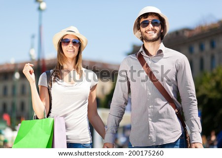 Toursits couple having nice time - stock photo