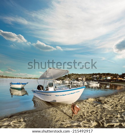 Toutristic motor boat by the shore in Ormos Panagias, Sithonia, Northern Greece
