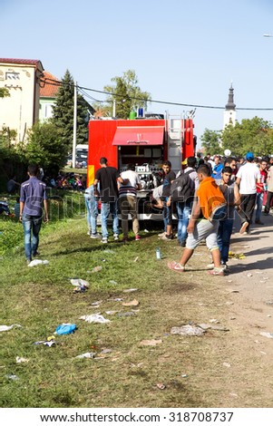 TOVARNIK, CROATIA - SEPTEMBER 18: The local Fire Brigade provides water to Refugees who arrive from Serbia on September 18, 2015 in Tovarnik, Croatia.