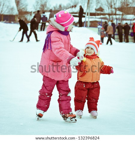 Tow girl in the skate on the ice. - stock photo