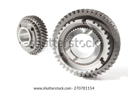 tow metal gears over white - stock photo