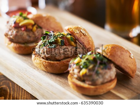 tow of three mini turkey burger sliders with brioche buns
