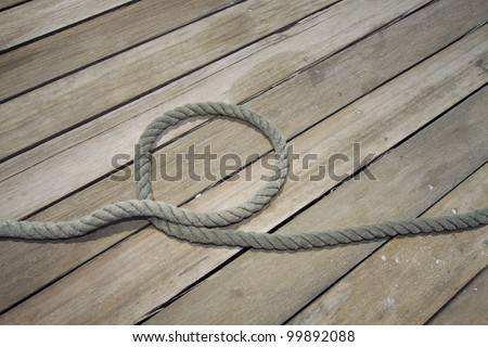 tow on a wooden jetty - stock photo