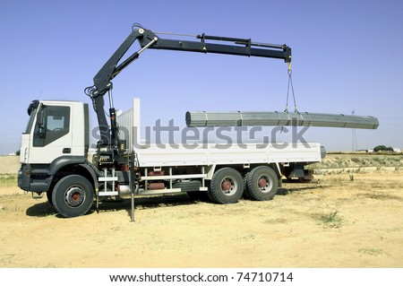 Tow truck, loading iron - stock photo