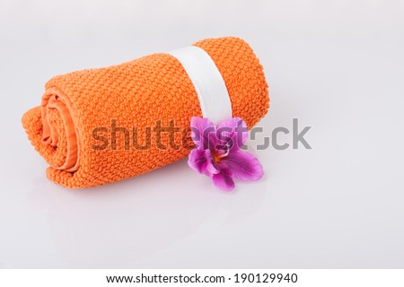 Towel and aromatic candle - stock photo