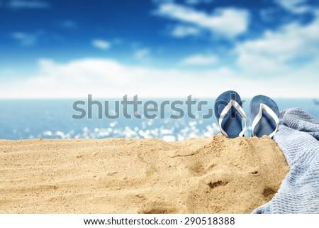towel and flip flops  - stock photo